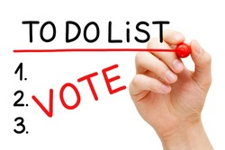 Hand writing the word Vote in To Do List with red marker isolated on white background. Elections participation reminder or planning concept.