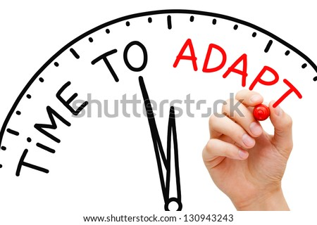 Hand writing Time to Adapt concept with red marker on transparent wipe board. Stockfoto ©