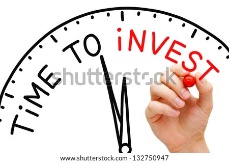 Hand writing Time to Invest concept with red marker on transparent wipe board.