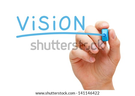 Hand writing Vision with blue marker on transparent wipe board.