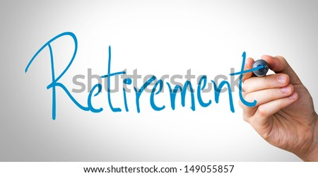 Hand writing with a blue mark on a transparent wipe board - Retirement