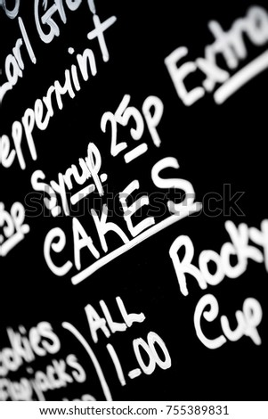 Hand written chalk menu board featured the word Cakes prominently #755389831