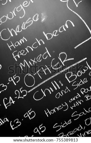 hand written chalk menu board featureing various ingredients