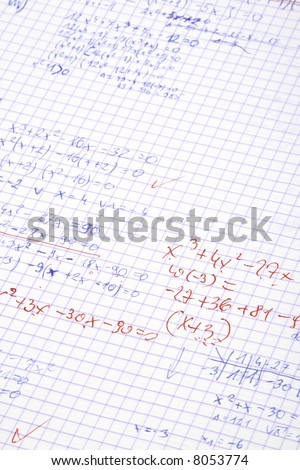 hand written maths calculations with teacher's corrections in red