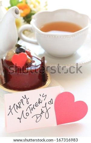 Hand written Mother's day card and cake for gourmet holiday food image