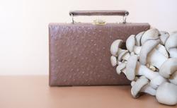 handbag made of mycelium leather, bio based sustainable alternative to leather made of mushroom spores and plant fibres. mushroom textile innovative materials. eco bio-gradable vegan leather