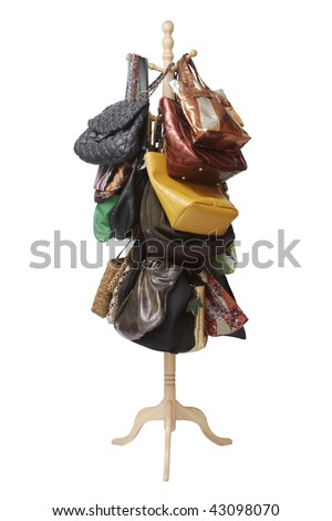 Handbags hanging on coat rack on white back ground.