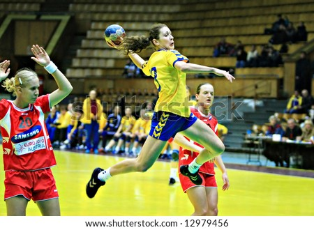 Handball player jumping with the ball.