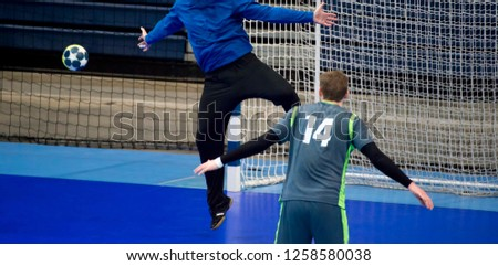 handball player trying to give a goal during a game #1258580038