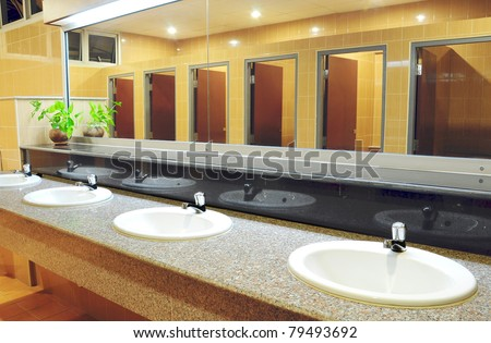 Handbasin and mirror in toilet