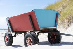 Handcart on the wide beach