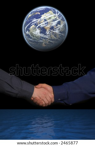 handclasp. two mens hands between blue ocean and globe isolated on black background