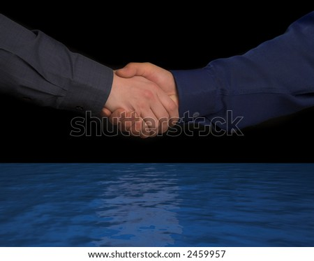 handclasp. two mens hands over world ocean isolated on black background - stock photo
