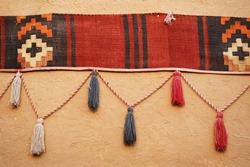 Handcraft of Saudi Arabia, traditional crafts, handmade. Handcraft decoration hanging on the mud wall in Riyadh, Saudi Arabia