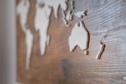 Handcrafted wooden world map with focus on New Zealand