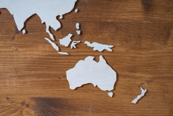 Handcrafted wooden world map with focus on Southeastern Asia and Oceania