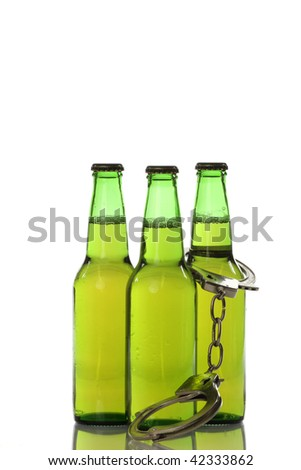 Handcuffed beer bottles representing alcohol addiction. Shot on a white background with a reflection.