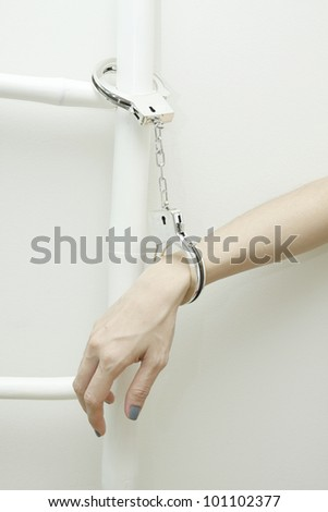 Handcuffed with white ladder on white background