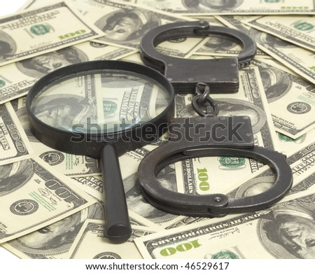 Handcuffs and loop on money background