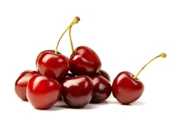 Handful of a red cherry on a white background