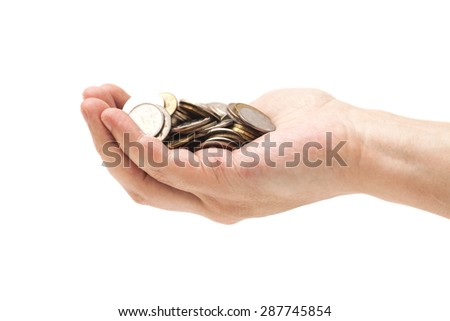 Handful of coins in palm hand isolated on white