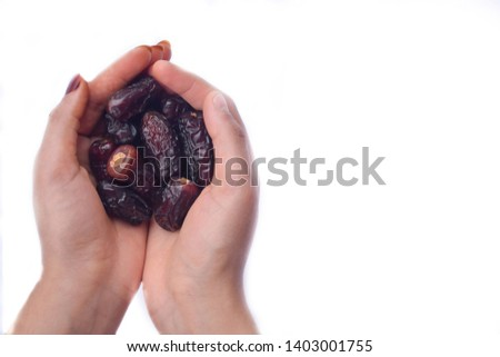 Handful of dates. Woman holding date palms.Date palms isolated.  #1403001755