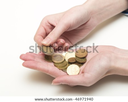 handful of euro coins in women's hands
