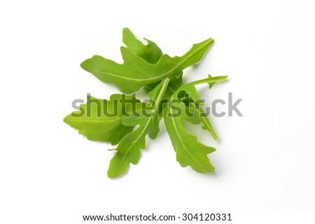 handful of fresh arugula leaves on white background Foto stock ©
