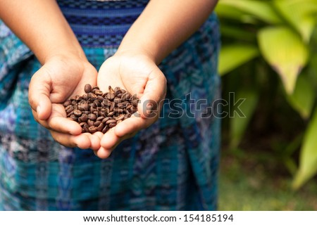 Handful of fresh organic coffee beans. Food and drink coffee background.