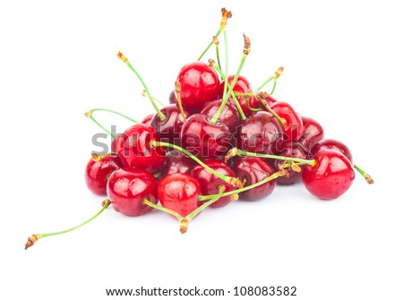 Handful of fresh red cherries isolated on white background