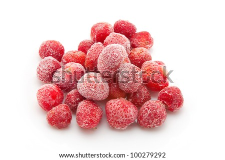 handful of frozen strawberries isolated on white background