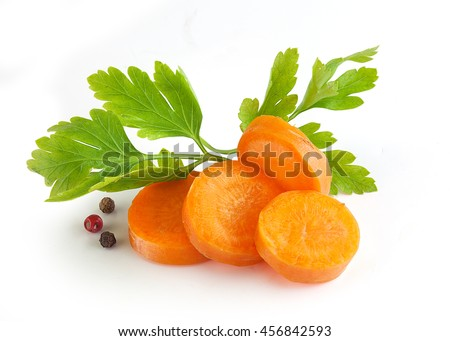 Handful of orange sliced carrot with a fresh green parsley and pepper