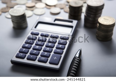 handful of Russian rubles with calculator close up