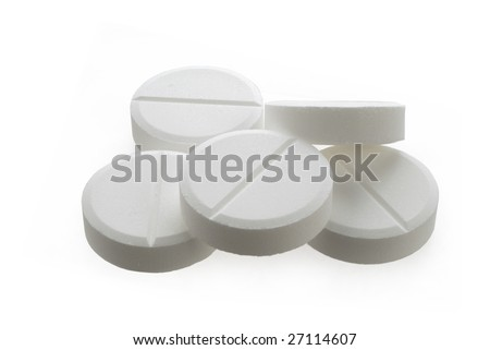 handful of white pills on a lid
