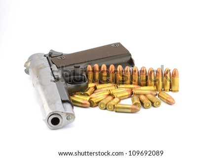 Handgun and bullets  on white background
