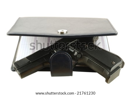 handgun in organizer, isolated on white background (closeup)