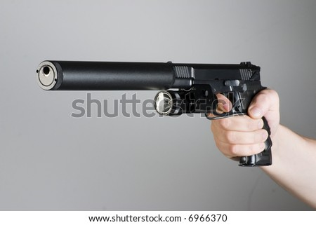 handgun in the hand - stock photo