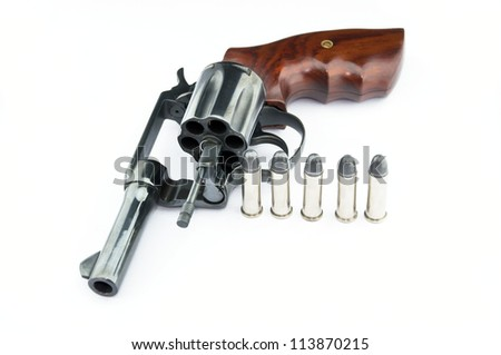 handgun revolver with bullets on white background
