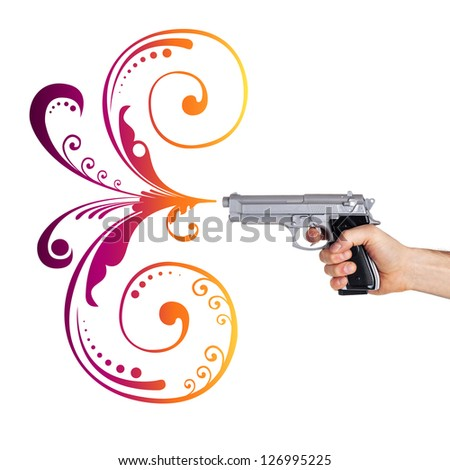 Handgun with abstract flower drawings in the end of the barrel isolated on white background.