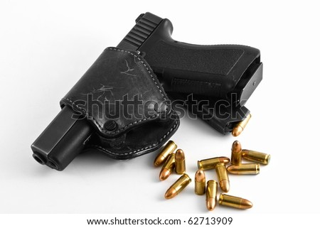 handgun with holster and shots