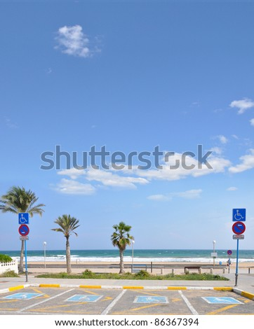 Handicap Parking at Mediterranean Beach in Urbanova a Costa Blanca City in the province of Alicante Spain Europe