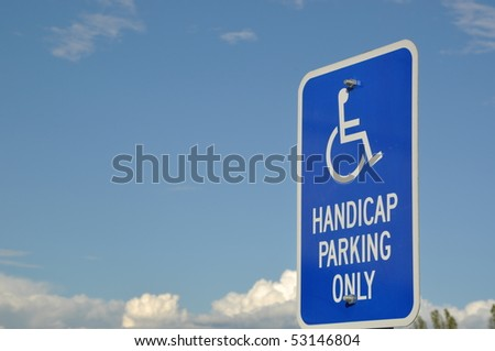 Handicap parking only sign with blue sky