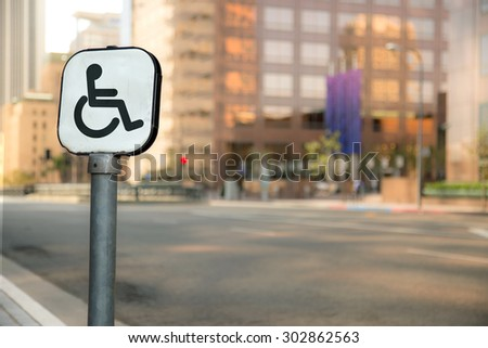 Handicap parking sign bokeh blurred blurry background urban city business district buildings downtown