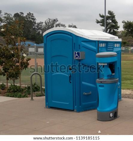 Handicap Portable Toilet in a Park #1139185115