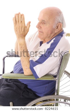 handicap senior praying in wheelchair - stock photo