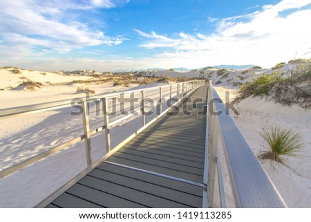 Handicapped Accessible Hiking Trail. Boardwalk accessible hiking trail through the beautiful American southwest desert of White Sands National Monument near Alamogordo, New Mexico.