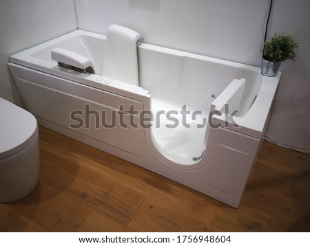 Handicapped disabled access bathroom bathtub with electric handles for people with disabilities Stockfoto ©
