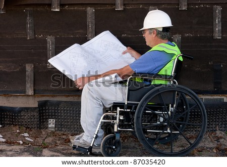 handicapped man in a wheelchair at a remodel job site