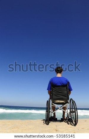 handicapped man in a wheelchair watching the sea