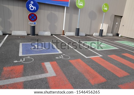 Handicapped parking car only electric vehicle ve pictogram on street #1546456265
